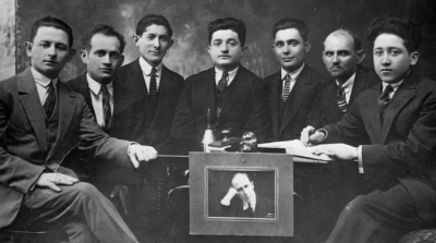 Board of the Jewish Labor Bund-affiliated leatherworkers and tanners union with a portrait of the late Bundist leader Vladimir Medem, Lublin, Poland, 1929. (YIVO)